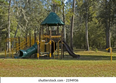 Modern playground equipment with slides and jungle gyms.