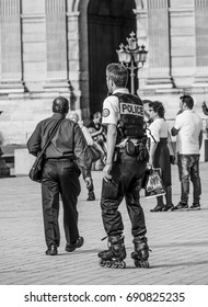 Modern Police officers on roller blades in Paris - PARIS / FRANCE - SEPTEMBER 24, 2017