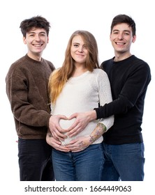 Modern polygamous family with one wife and two husbands. Young pregnant woman posing with two young man on a white background