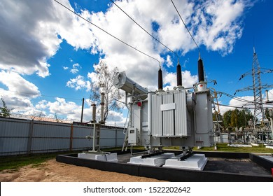 modern powerful transformer substation with a variety of high-voltage connected wires and cables, electrical equipment in the protected area maintains a stable voltage of energy in the city