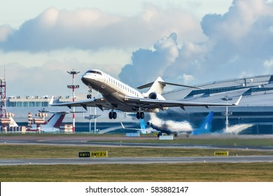 Modern private business jet taking off.