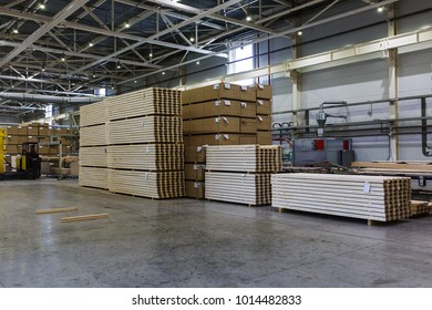 Modern production and storage room with lumber produced and ready for shipment. Storage and production. Industrial photography inside the demonstration production facilities.