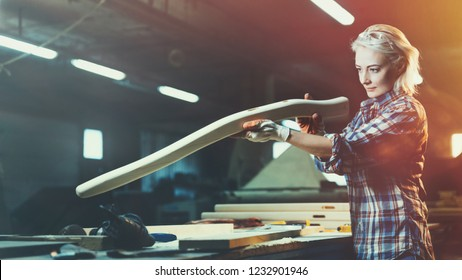 Modern professionally-oriented middle aged woman masters a new profession in the workshop. Concept of motivated women, gender equality, image of femininity in modern world