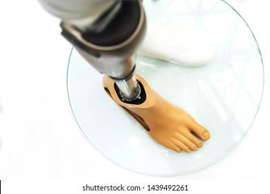 Modern prosthetic leg. Demonstration of modern prosthetic technologies. Foot feet. View from above.