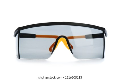 Modern protective goggles isolated on white. Construction tools