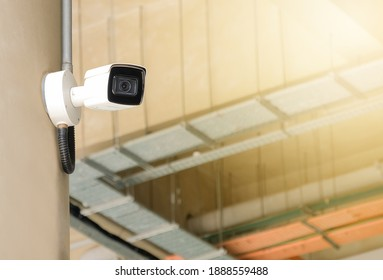 Modern public CCTV camera on wall. Intelligent recording camera for monitoring all day and night. Concept of surveillance and monitoring with copy space.