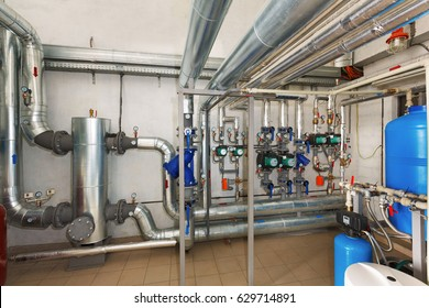 Modern pumping station with water treatment system in industrial gas boiler house