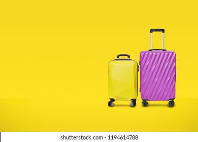 Modern purple yellow suitcases bag on yellow background. luggage set for copy space. minimal concept.