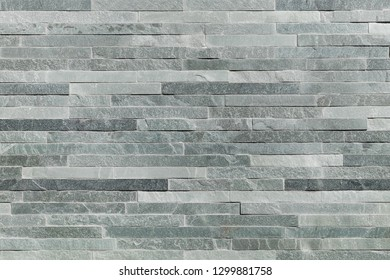 Modern quality natural stone tiling, Natural split stone quartzite stone wall structured by linear pattern background