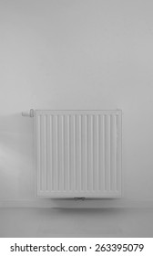 modern radiator on wall with epoxy flooring