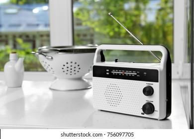 Modern radio on table in kitchen