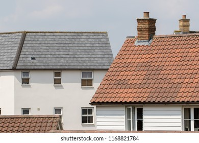 Modern real estate. Housing market choices and the property ladder. Contemporary suburban homes and apartment accommodation.
