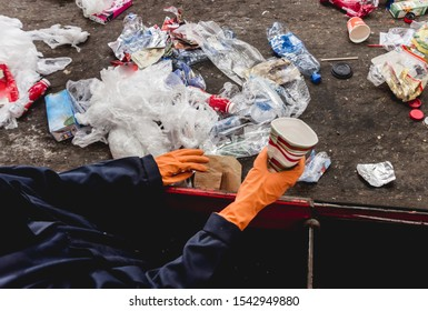 At modern recycling plant. Separate garbage collection. Workers sorting trash to be processed. Trash sorting. Background