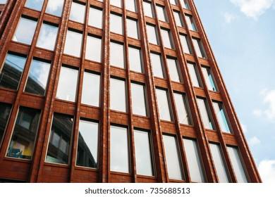 modern red brick finance facade
