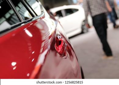 Modern red car. Auto handle. Auto show