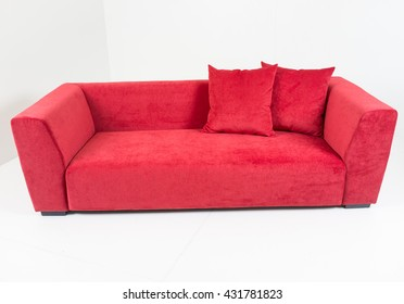 Modern red furniture in white room