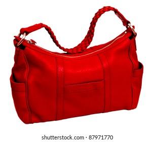 Modern red leather women's handbag on the white background