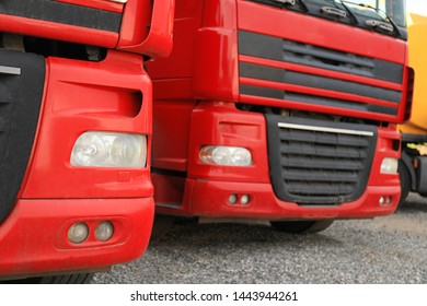 Modern red trucks parked on road, closeup