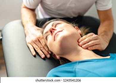 A Modern rehabilitation physiotherapy man at work with woman client woking on neck