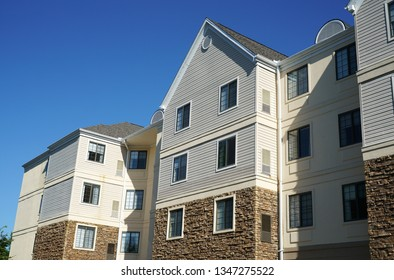modern rental apartment buildings in sunny day