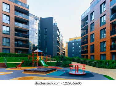 Modern residential apartment building architecture concept. Children playground, outdoor facilities