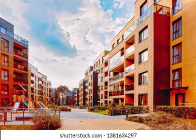 Modern residential apartment building exterior concept. Children playground, outdoor facilities