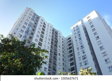 Modern residential Apartment high building outdoor low angle. Residential housing project condominium real estate in vietnam