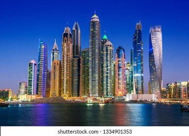 Modern residential architecture of Dubai Marina, United Arab Emirates. City skyline by night.