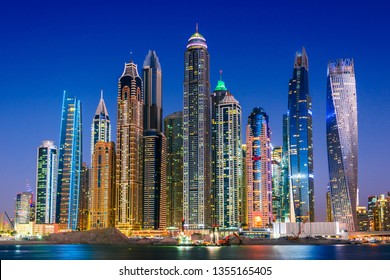 Modern residential architecture of Dubai Marina, United Arab Emirates. City skyline by night.