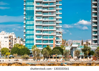 Modern residential buildings and pedestrian walkway along the seafront. Limassol, Cyprus.