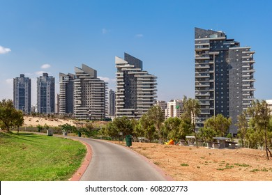 Modern residential complex of buildings under blue sky in Ashdod, Israel.