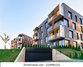 Modern residential home apartment building architecture with garage. House and parking concept.