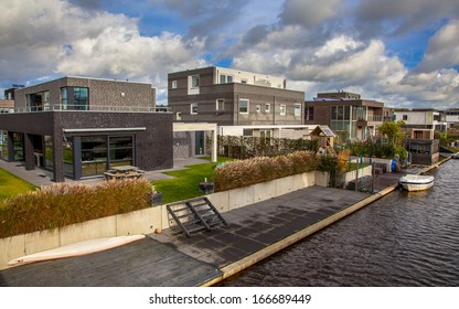 Modern residential Middle Class Houses on the Water Front in a Suburban Area