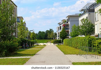 Modern residential quarter in a small Bavarian town, buildings with gardens, terraces and green pedestrian areas