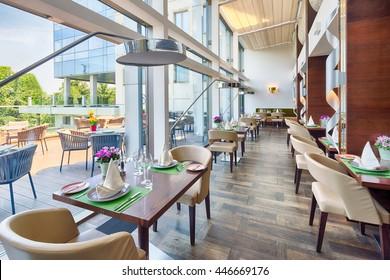 Modern restaurant interior on balcony, part of a hotel