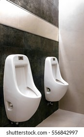 modern restroom interior photo with urinal row