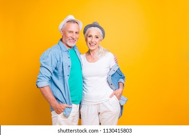 Modern retirement happiness friendship cuddle concept! Life is good! Photo portrait of cheerful delightful cool trendy joyful excited parents standing together isolated on vivid background copy-space