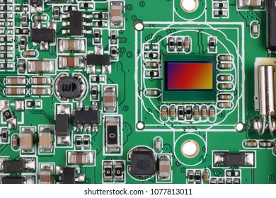 Modern RGB image  sensor from digital photo camera established on the standard  mass production printed circuit board. Top view studio macro shot