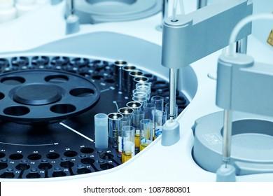 Modern robotical machine for centrifuge blood and urine testing. Hospital laboratories, automatic biochemical analyzer.