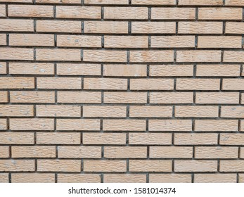 Modern rock stone wall background made of bricks on a wall of the building with rough texture and interesting antique retro natural pattern
