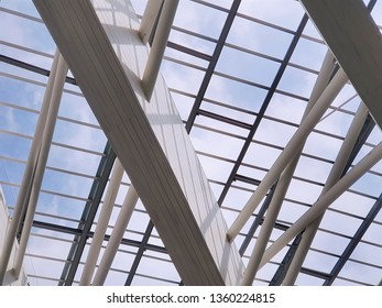 Modern Roof Structure Against Blue Cloudy Sky