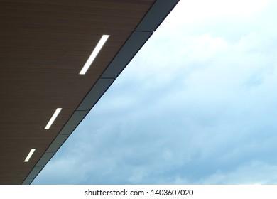 modern roof  structure airport station terminal lights and blue sky