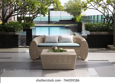 Modern roof top with sofa and furniture with pool.