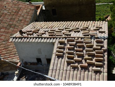 Modern roofing with the arched imbrex tiles on the cement corrugated sheets