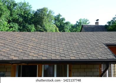 Modern roofing and decoration of chimneys. Flexible bitumen or slate shingles