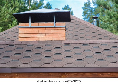 Modern roofing and decoration of chimneys. Flexible bitumen or slate shingles.
