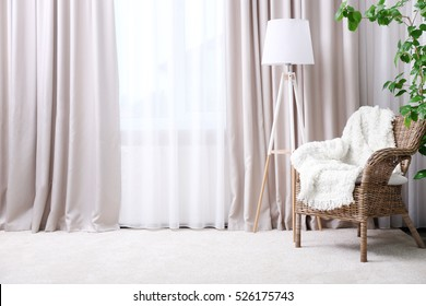 Modern room interior with armchair and curtains