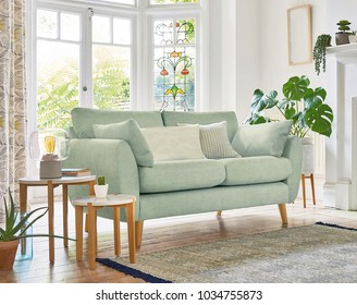 Modern room interior with armchairs and sofa