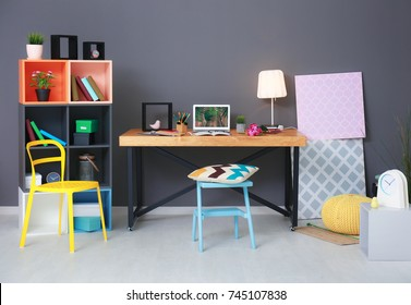 Modern room interior with laptop on table
