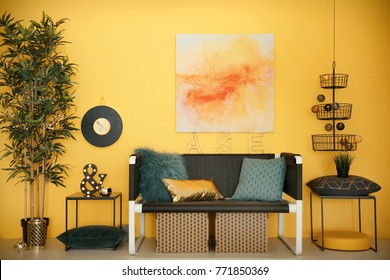 Modern room interior with stylish sofa